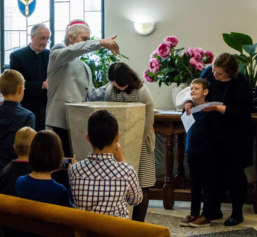 baptism by the chaplain at the font