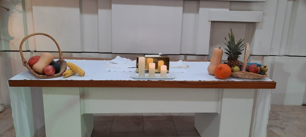 communion table with harvest decorations